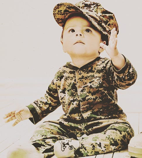 Baby in camo outfit